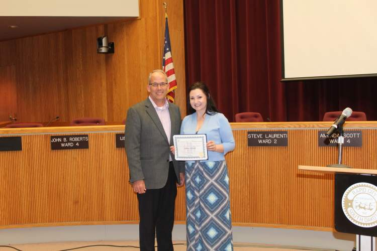 Mayor Steve Allender and Amber Oldfield.  Oldfield was recognized at the April 17 City Council meeting as the City's first Hidden Hero of the Month for her work as a veteran caregiver and caregiver advocate.