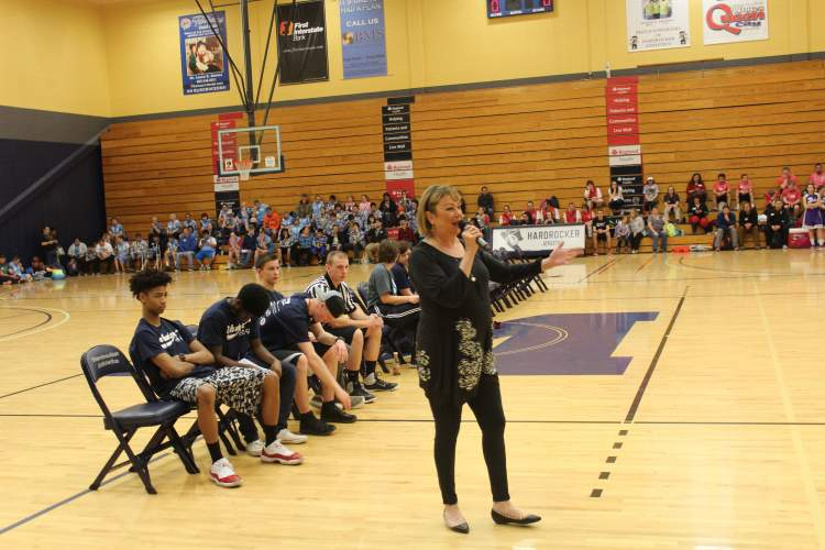 "Council member Darla Drew provides a greeting, including leading the participants in ""We Are The Champions"" at the opening ceremonies of Friday's Special Olympics basketball tournament."