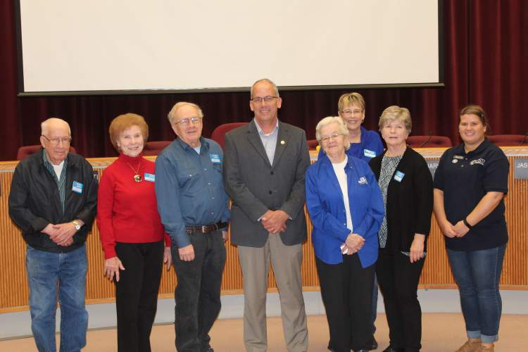 Volunteers of various groups pose with Mayor Steve Allender at Tuesday's proclamation signing ceremony.  From left, Art Thompson, Penny Dawson, Tim French, Mayor Allender, Pat Rohrback, Jan McArthur, Lorann Berg, and Mary Adams.  Art, Penny, Tim, Jan and Lorann are with the Black Hills RSVP+ Program; Pat is with the Senior Companions Program and Mary is with the AmeriCorps VISTA Program.