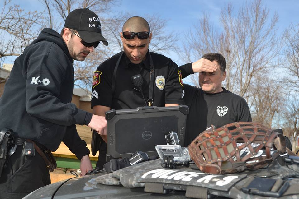 RCPD K9 Officers Jason LaHaie and Marcos Glass on the computer