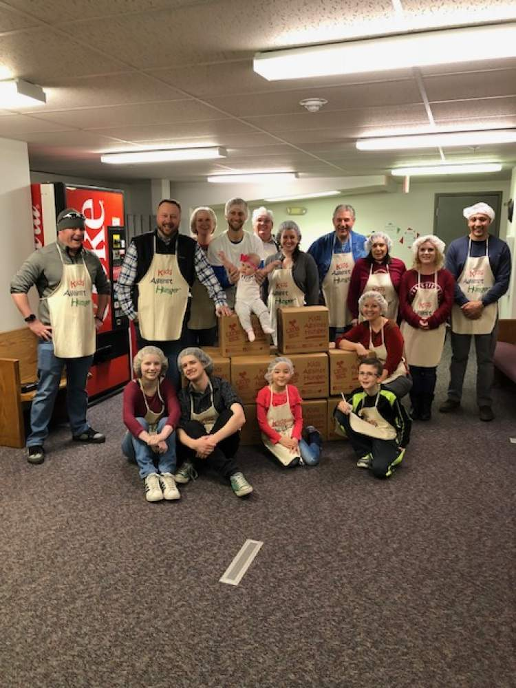 City Council members and City staff and family members gathered April 7 to pack food bags for Kids Against Hunger.