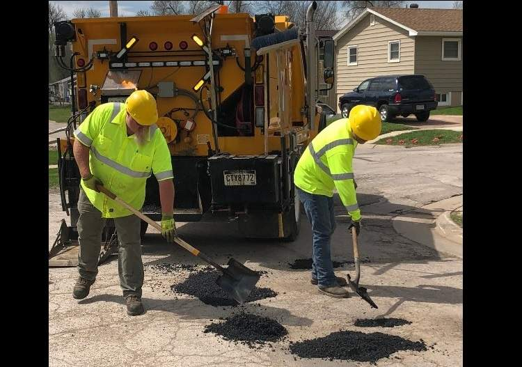 A City pothole patching crew at work.