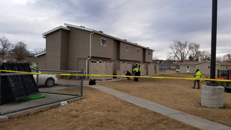 Police investigating homicide at 313 E. Adams Street, suspect in custody