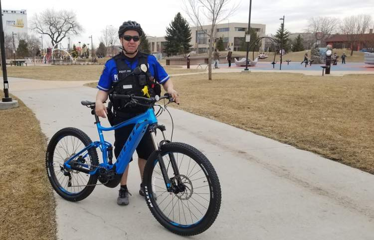 Officer Anthony Picket Pin with one of the RCPD's new electric bikes
