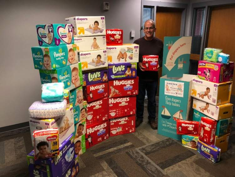 Mayor Steve Allender poses with some of the 3500 diapers collected at City Hall during the 2019 Diaper Need Awareness Week collection drive. City Hall is again serving as a collection site for diapers during this year's Diaper Need Awareness Week Sept. 21-25 and through October 2.