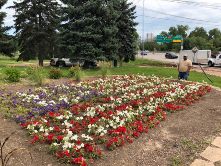 Patriotic Flower-Power: Flag-in-Flowers On Display at Major Intersection