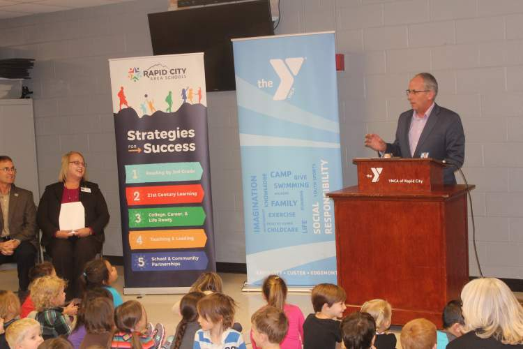 Rapid City Mayor Steve Allender joins YMCA, Rapid City Schools and Black Hills Energy officials in Tuesday's announcement regarding future plans for the YMCA, Black Hills Corporation Building and the City/School Administration Center.