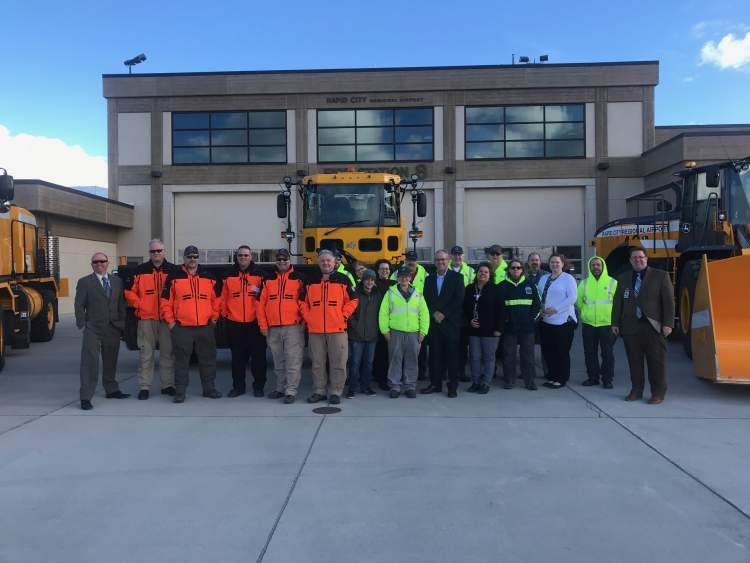 Mayor Allender and the Rapid City Regional Airport staff, celebrating a record-setting 2017.