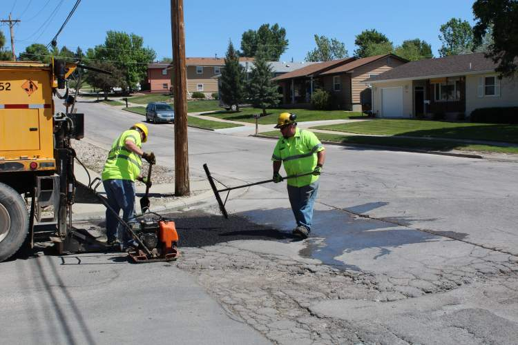 If you have a pothole issue, call the City's Pothole Hotline at 394-4152.