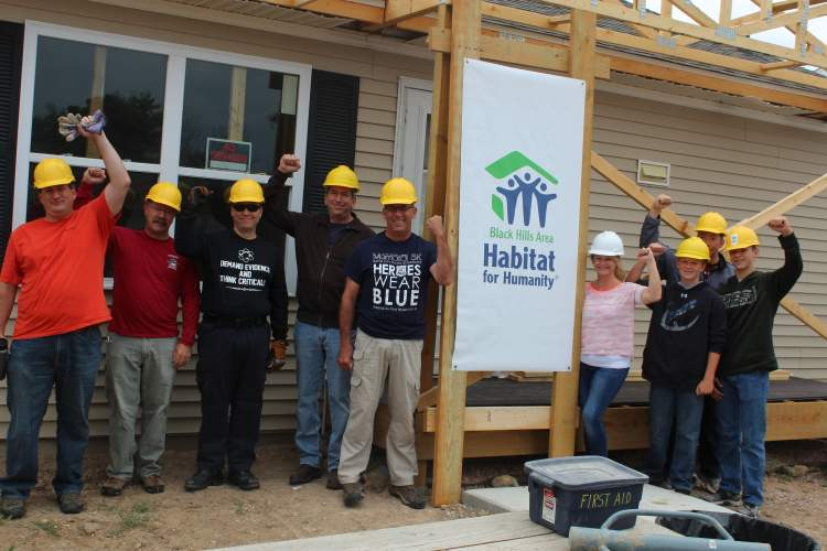 Some of the participants for the Mayor's Team Build for Black Hills Habitat for Humanity at the Garfield Green project.
