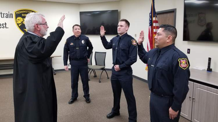 Officer Delfs (left) and Officer Romero (right) are sworn in as officers of the RCPD