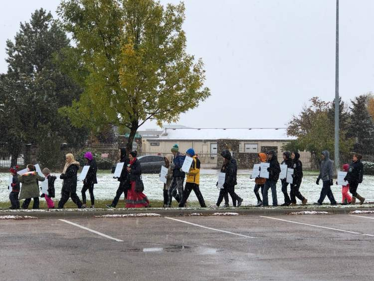 Walkers participate in the 2018 Remembering The Children Memorial Walk. This year's Memorial Walk is scheduled for 10 a.m. Monday beginning at Sioux Park and will be followed by a groundbreaking ceremony for a memorial in the open field behind Canyon Lake Methodist Church and West Middle School.