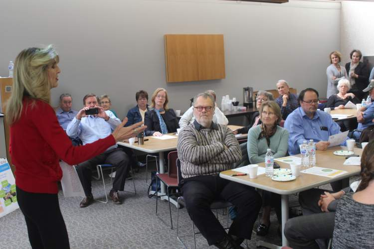 "Community Planning and Development's Vicki Fisher addresses a standing-room only crowd in the Community Room November 8.  The ""Coffee With Planners"" event was hosted by the Department with a number of issues addressed, updates provided and questions fielded."