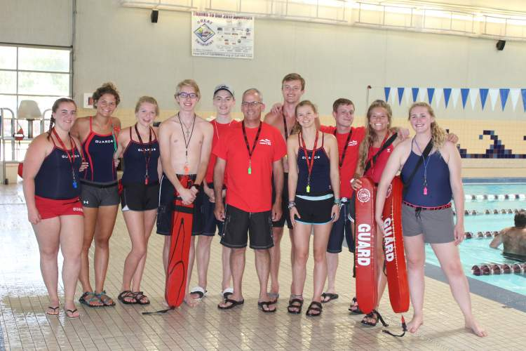Mayor Steve Allender with Rapid City Swim Center lifeguards in this City file photo.  The City is seeking lifeguards for this summer to serve at the City's pools.
