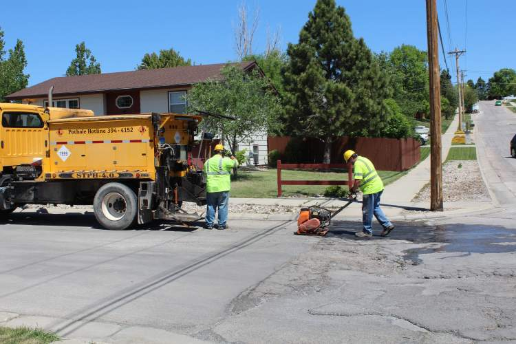 A crew from the City's Street Department fills potholes in south Rapid City.