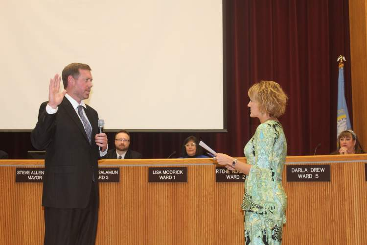 Nick Stroot is sworn in as the City's Community Resources Director by Finance Director Pauline Sumption at the October 16 City Council meeting.