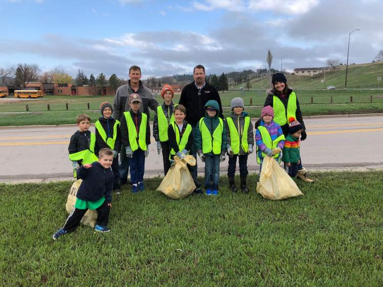 A group cleans up around the Little League fields in west Rapid City during Clean-Up Week 2019.