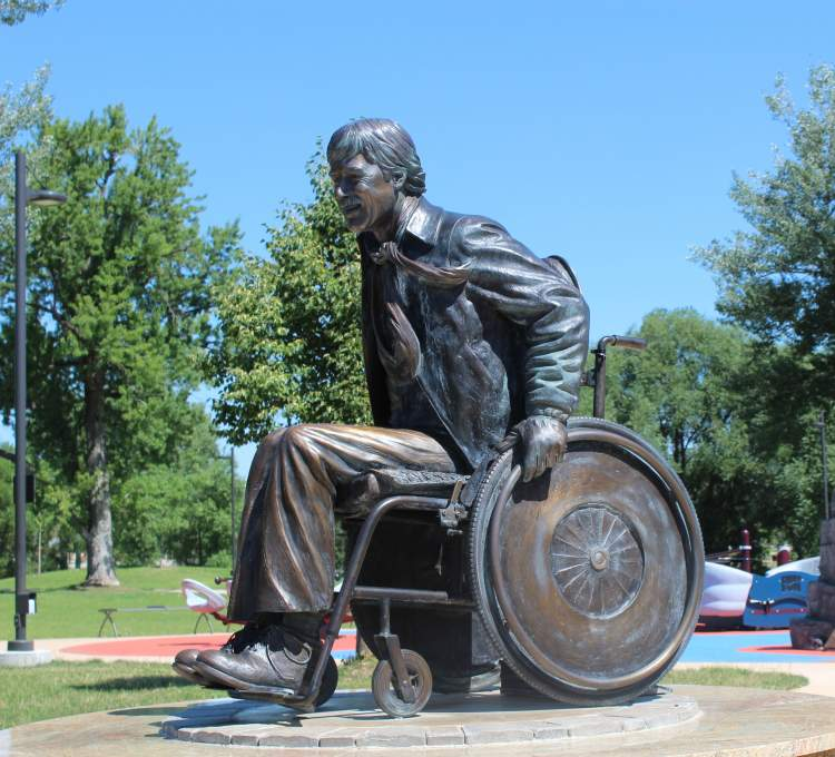 Long-time Mayor's Committee member and disability rights advocate Scotty Backens is memorialized in this statue in Memorial Park.  The Mayor's Committee for People with Disabilities will be hosting the annual ADA picnic in Main Street Square July 26.