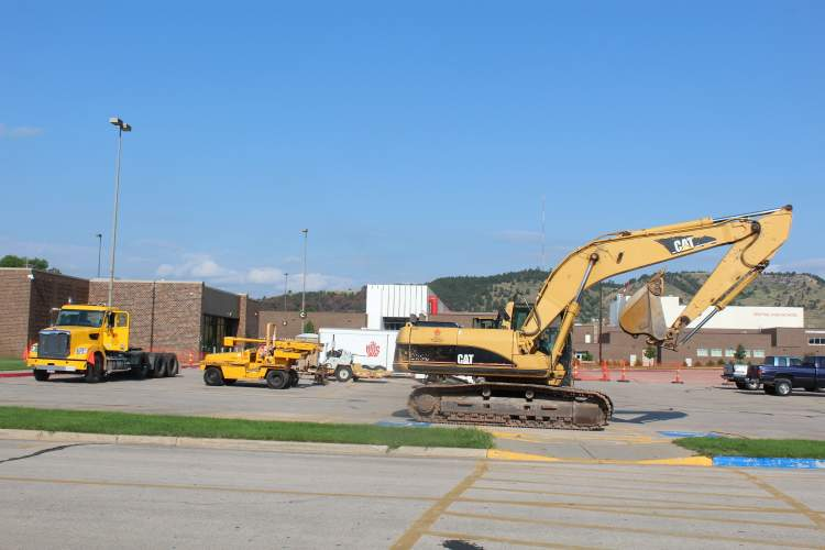 Construction crews have initiated work on parking lot improvements on the west side of the Rushmore Plaza Civic Center.