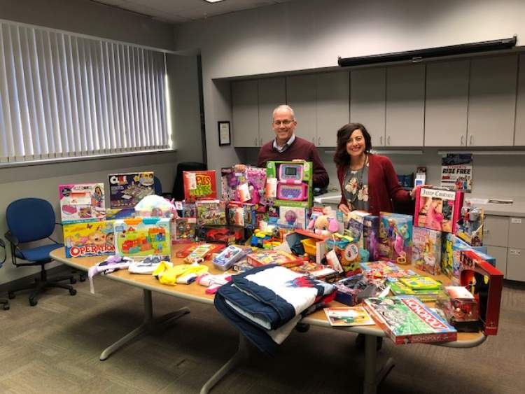 Mayor Steve Allender and Council member Laura Armstrong review just some of the Angel Tree gifts provided this season.