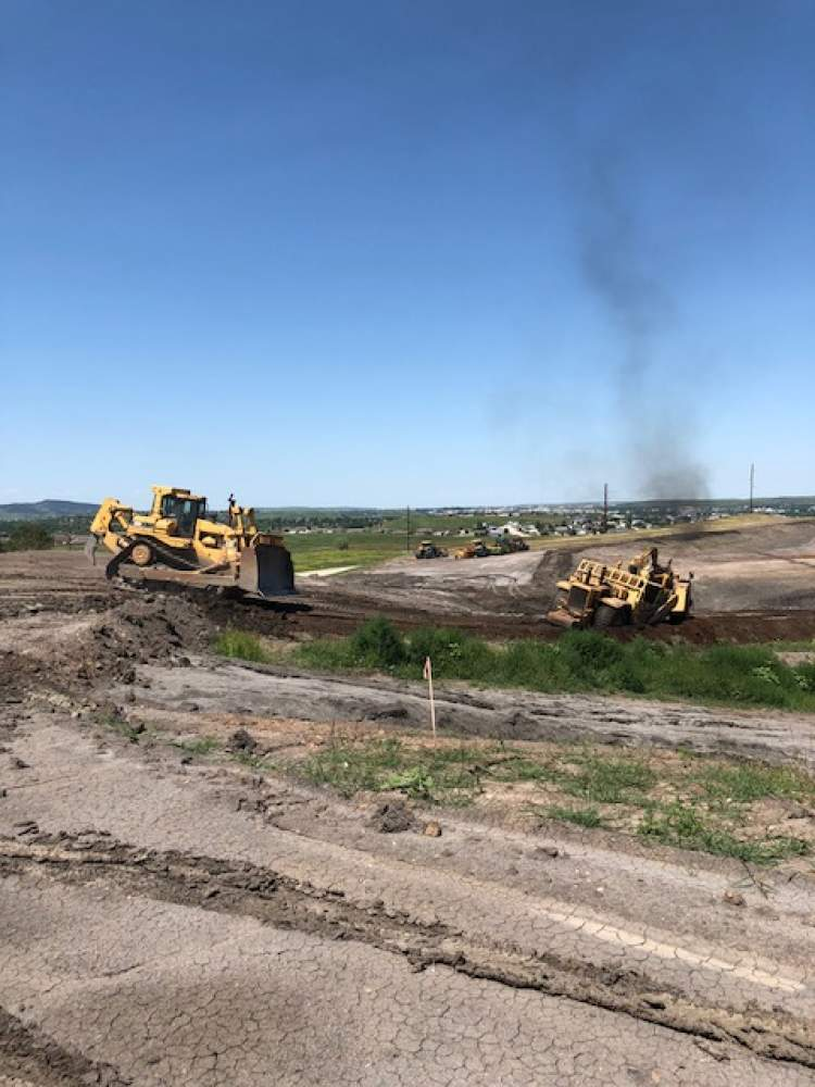 Contractors clearing an area for a new landfill cell at the Rapid City Landfill.