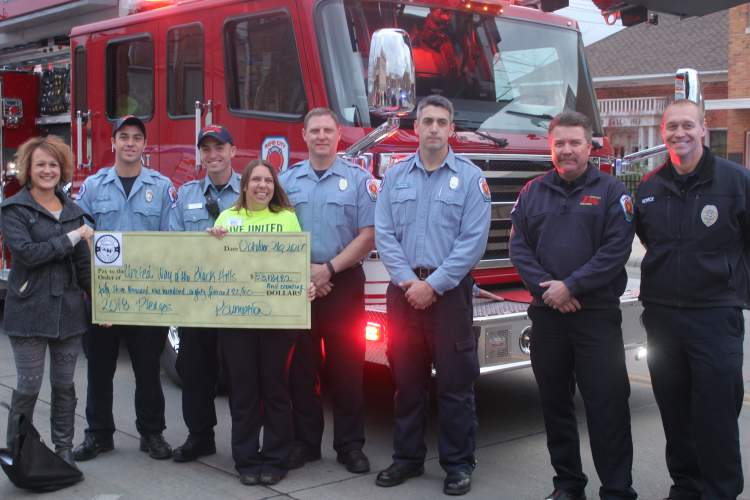 City Finance Director Pauline Sumption and members of the City's Fire and Police Department gather for a pledge presentation of $53,000 to Jamie Toennies of United Way of the Black Hills.